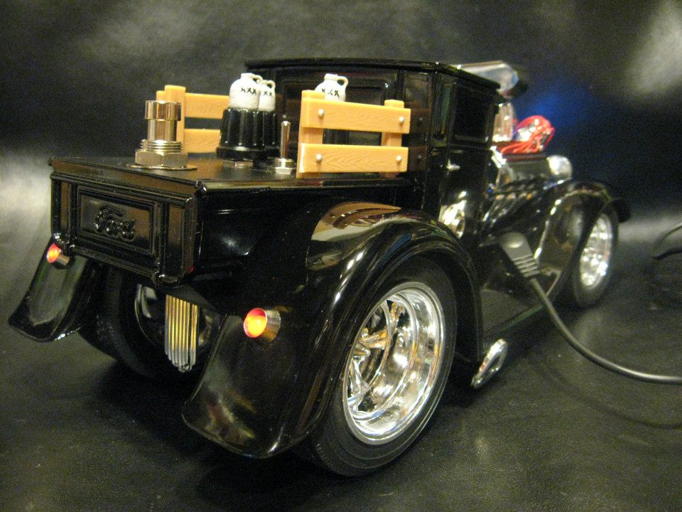 1-18 scale diecast 1929 Ford Model A with a Bass Guitar Fuzz effect pedal built into it. All hand wired on circuit board.