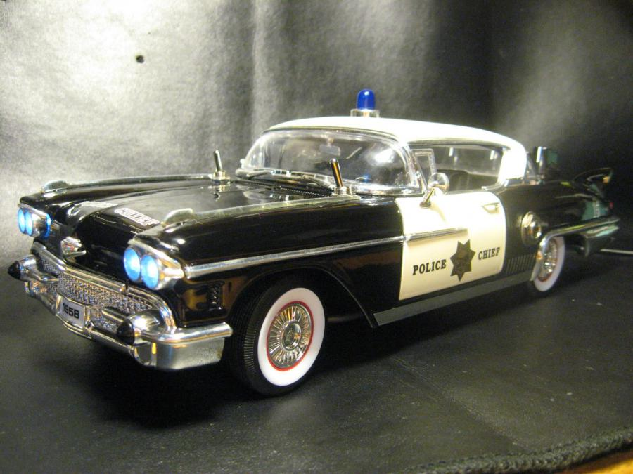 Overdrive/Boost built into a 1:18 scale 1958 Caddy Police Car. Three voice selector and bass boost switches. All true bypass.