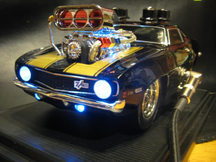 "1:18 scale Die cast '69 Chevy Camaro Z28 with a guitar overdrive pedal hand wired into it. Circuit is hand built on prototype board and based on the killer Zendrive circuit schematic which has been called a ""Dumble in a Box""."