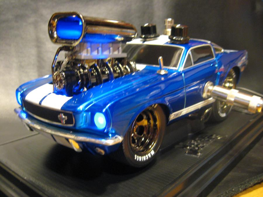 "<div style=""text-align: left;"">1:18 scale Shelby Mustang. Since the color of the car is such a nice chrome blue, I decided to go with all high bright blue lights everywhere including the headlights. Killer overdrive with a bass boost switch and 3-way voicing switch for the overdrive tones.</div>"
