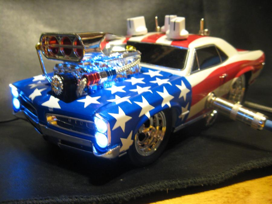 "<div style=""text-align: left;"">Custom ordered by YouTube guitar gear guru, GearMannDude. Custom made, hand wired Overderive/Boost built into a 1:18 scale 1966 Pontiac GTO die-cast car<br /> GearMannDude's description:  LOVE LOVE LOVE THIS THING! The tone matches the bad ass looks for sure. It's like the ultimate toy meets trophy meets tone sandwich. God Bless the USA & 60's muscle cars! STARS and STRIPES</div>"