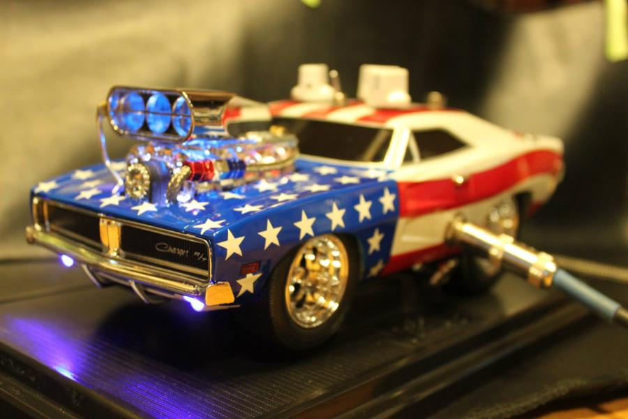 "<div style=""text-align: left;"">Custom made, hand wired Distortion effect built into a 1:18 scale 1969 Charger with a American flag theme. The proceeds of sale will be donated to help wounded soldiers and their families. <br /> Features a 3-way voicing switch that changes the characteristics of the distortion tone. Switch position 1 will light and fade the lights in the engine blower with the intensity of the guitar signal. Switch position 3 will light and fade both sides of the inner tail lights with the intensity of the guitar signal.</div>"